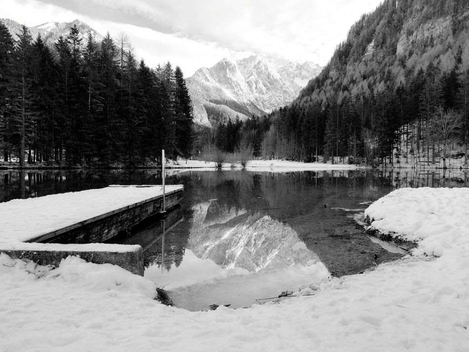 Lake View Reflection Reflections In The Water Bnw Bnw_friday_eyeemchallenge Eye4photography  EyeEm Best Shots - Black + White EyeEm Masterclass Exceptional Photographs Blackandwhite Black & White Monochrome Photography Backgrounds EyeEm Selects Still Life Snow Mountain Winter Outdoors Sky Nature Day Cold Temperature Mountain Range Beauty In Nature Scenics Water No People Tree Cloud - Sky EyeEm Ready   EyeEmNewHere AI Now