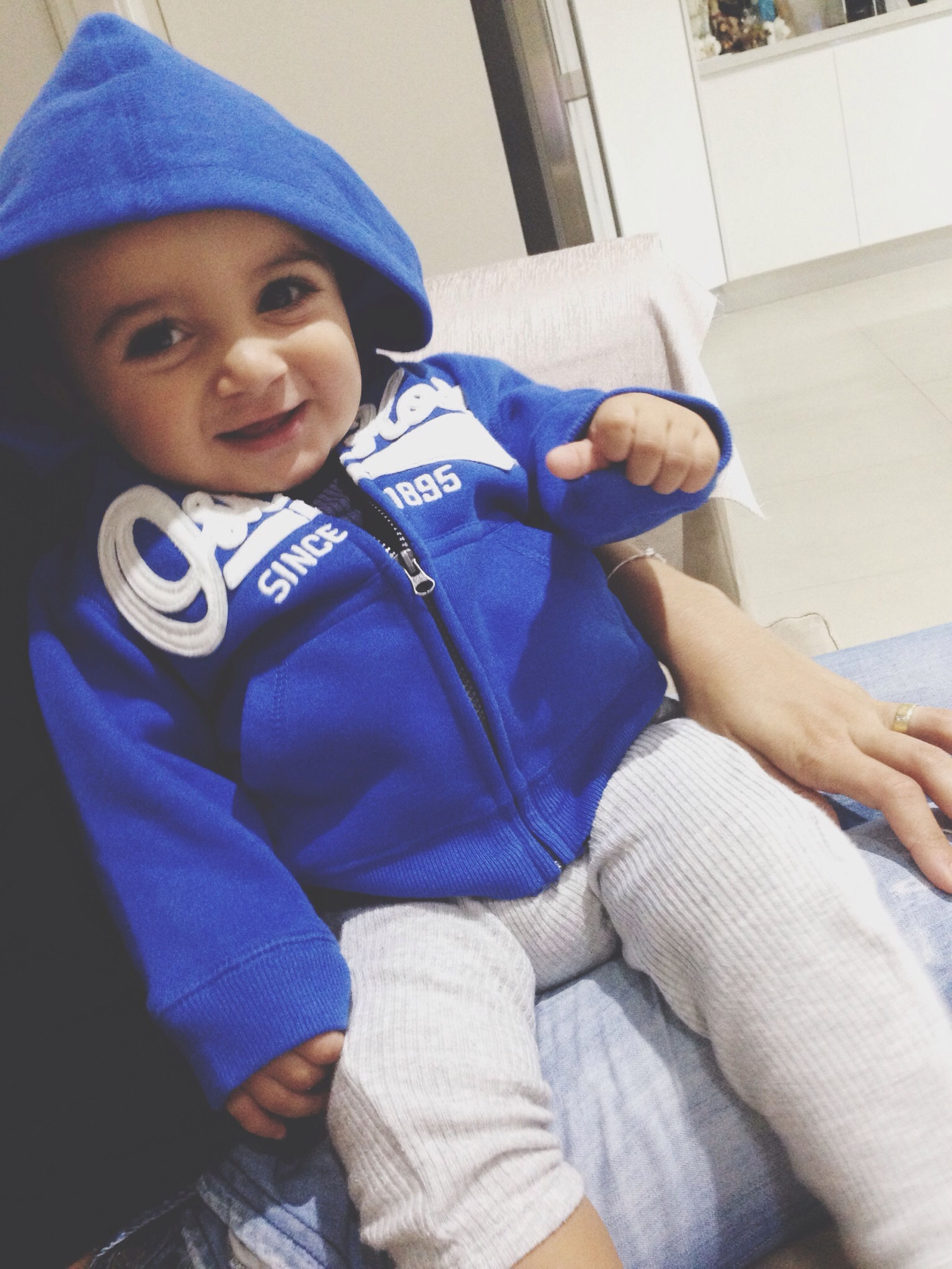 childhood, indoors, person, casual clothing, innocence, elementary age, cute, boys, lifestyles, toddler, babyhood, baby, leisure activity, home interior, relaxation, three quarter length, sitting, front view