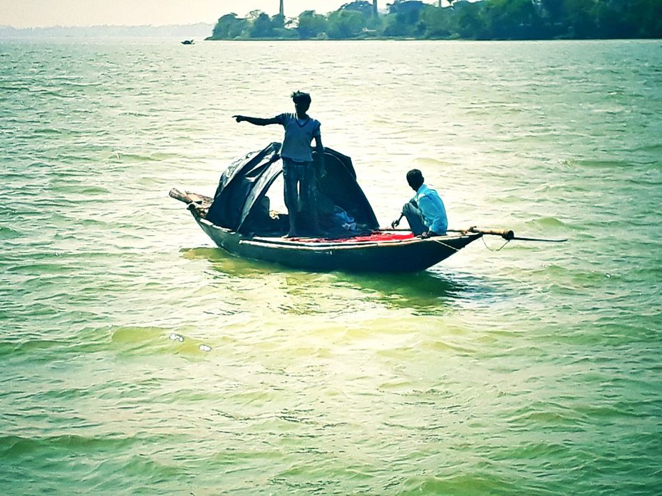 Nautical Vessel Adventure Transportation Sea Travel Destinations Vacations People Outdoors Adult Day Oar Teamwork Astrology Sign Water Adults Only ganga river nouka noka First Eyeem Photo