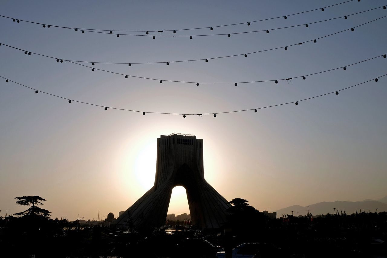 Silhouette Azadi Tower At Against Clear Sky During Sunset