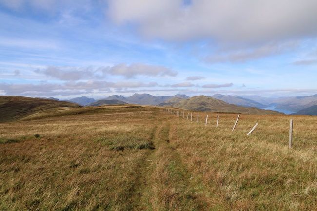 Hiking in scotland with a great view on Loch lamond Scotland LochLomond Hiking Landscape Tranquil Scene Grass Scenics Tranquility Mountain Sky Fence Mountain Range Field Remote Cloud Non-urban Scene Beauty In Nature Cloud - Sky Nature Solitude Grassy Outdoors Countryside