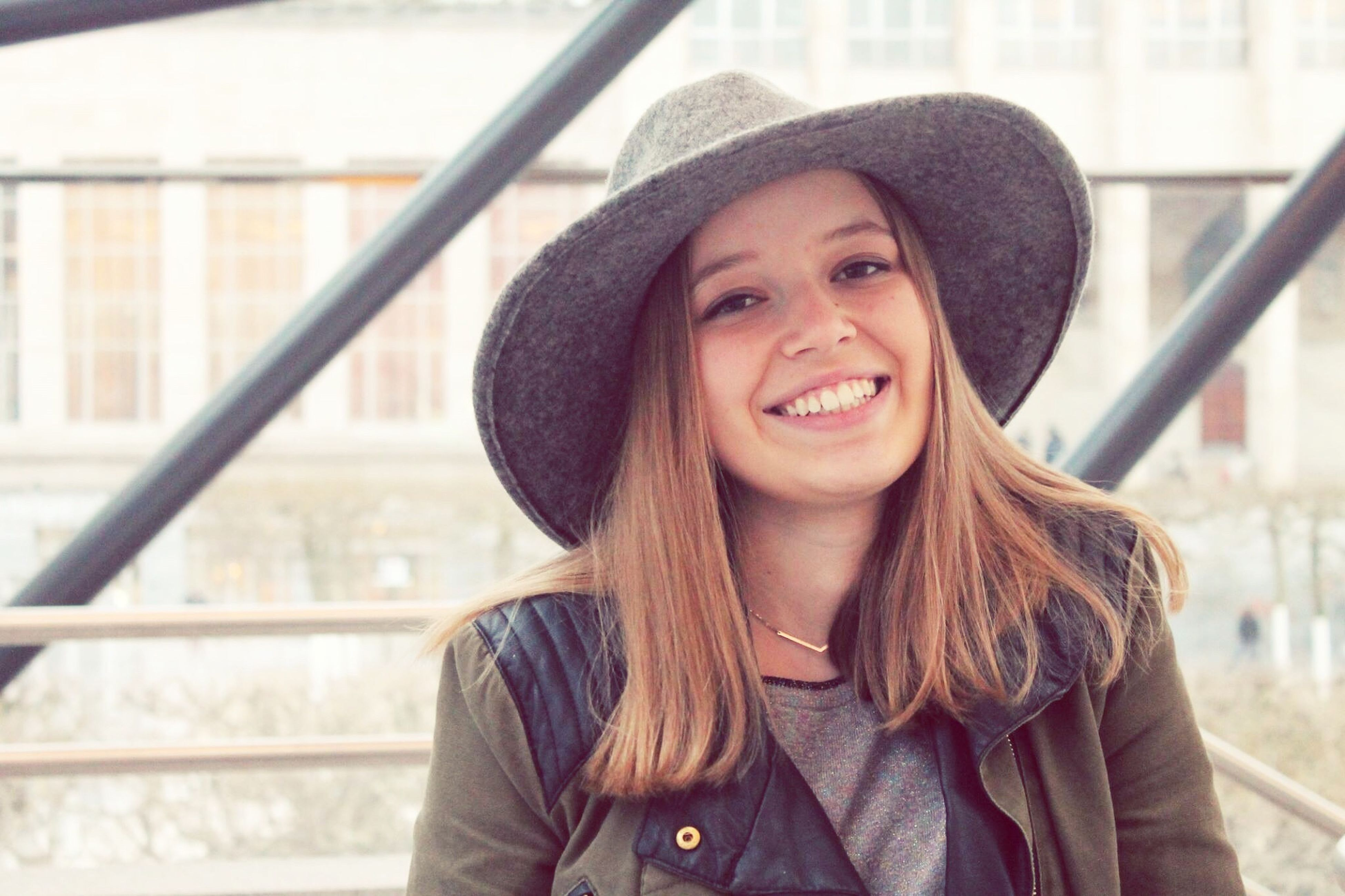 young adult, portrait, person, looking at camera, lifestyles, smiling, front view, young women, casual clothing, leisure activity, happiness, long hair, focus on foreground, toothy smile, standing, waist up, headshot