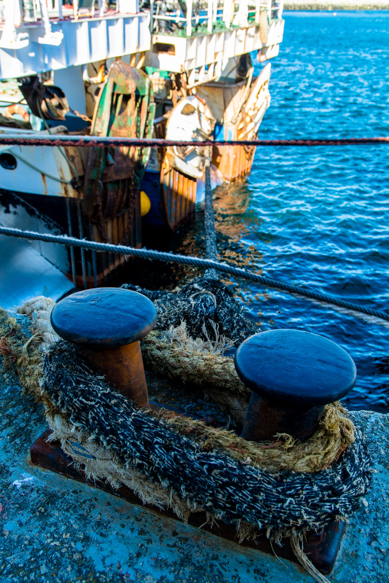 Blue Bolarde Color Photography Day Dock Fishing Village Harbour Moored Nature No People Outdoors Rope Ropes Rusty Sead Ship Ships Steel Sunny Day Vertical Water