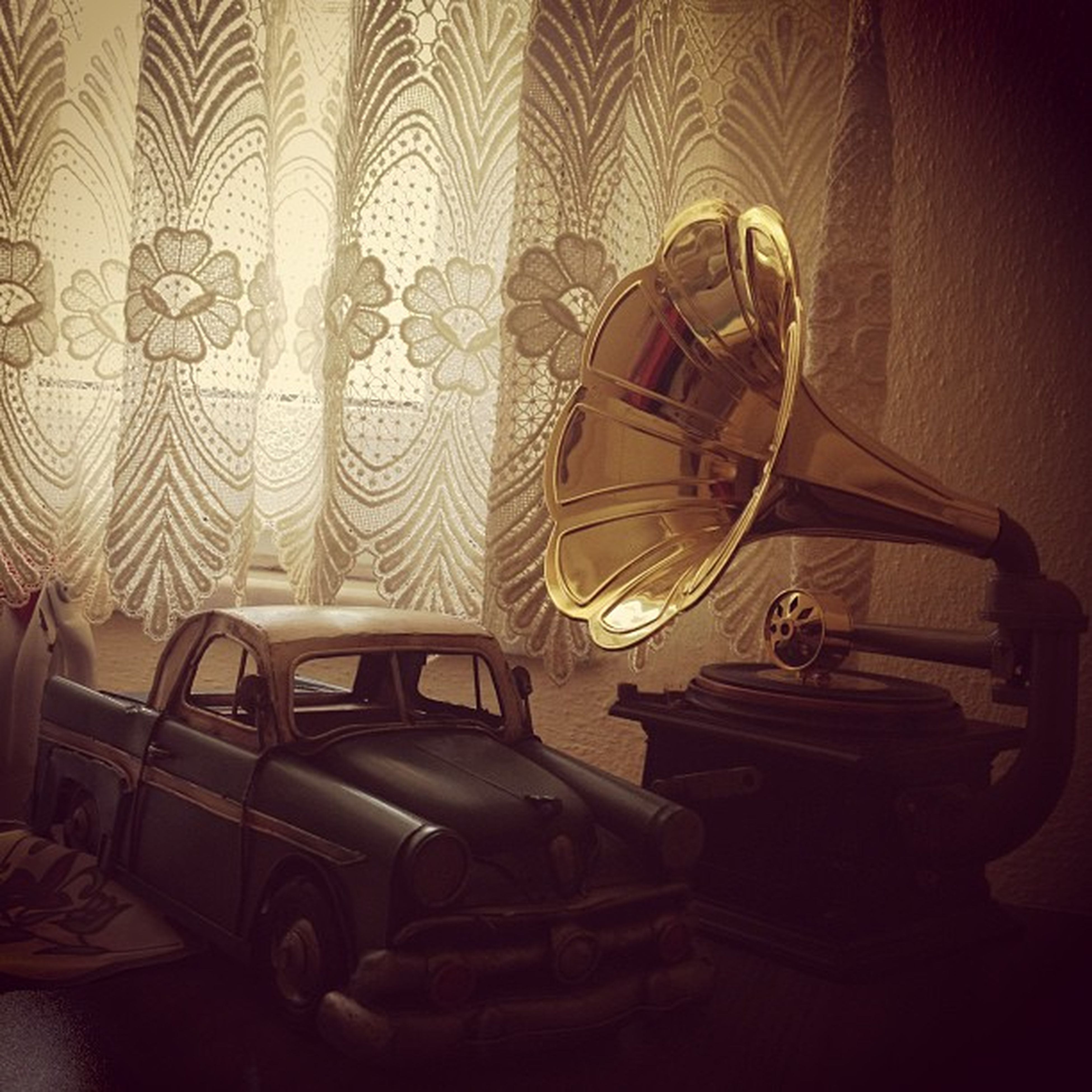 indoors, home interior, ceiling, illuminated, arts culture and entertainment, wall - building feature, no people, old-fashioned, pattern, interior, technology, absence, lighting equipment, chair, design, chandelier, hanging, room, still life, luxury