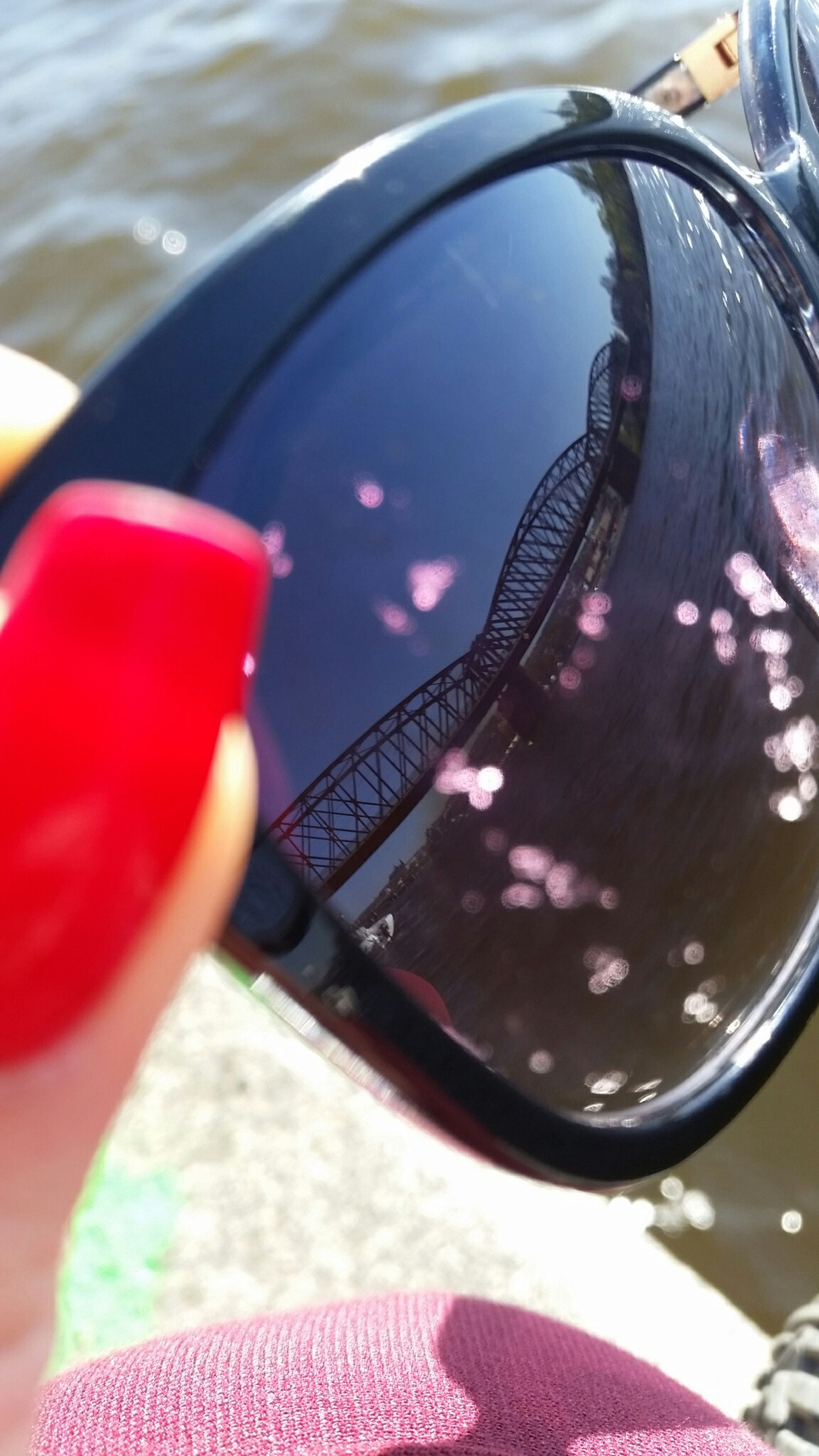 part of, close-up, focus on foreground, mode of transport, cropped, land vehicle, transportation, car, reflection, water, red, day, glass - material, indoors, person, transparent, sunglasses