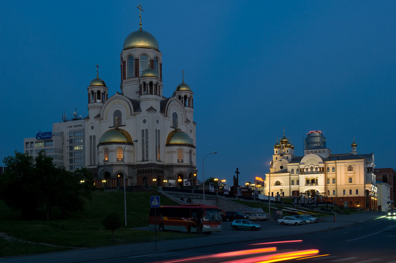 religion, place of worship, spirituality, architecture, built structure, building exterior, dome, outdoors, history, cross, travel destinations, blue, illuminated, road, clear sky, sky, day, no people, city