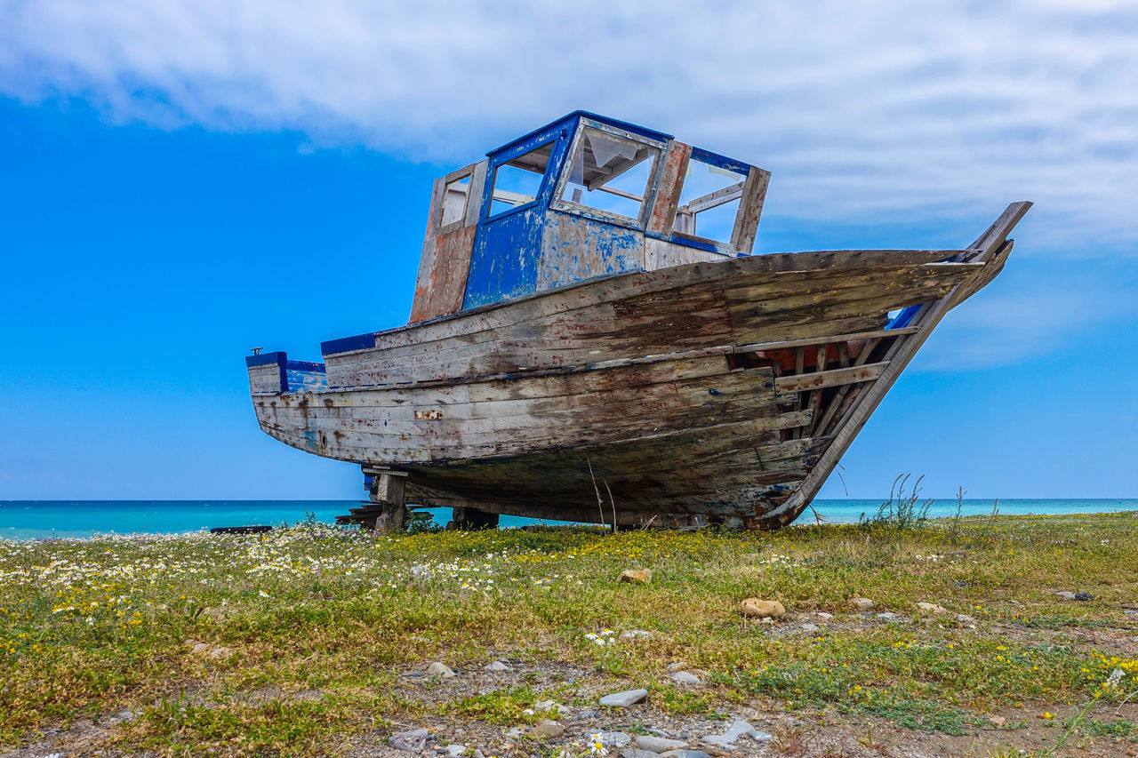 abandoned, sea, nautical vessel, damaged, obsolete, deterioration, run-down, transportation, nature, boat, water, beach, sky, horizon over water, rusty, sinking, outdoors, ship, day, no people, bad condition, grass, cloud - sky, beauty in nature, destruction, scenics, sunken, desolate