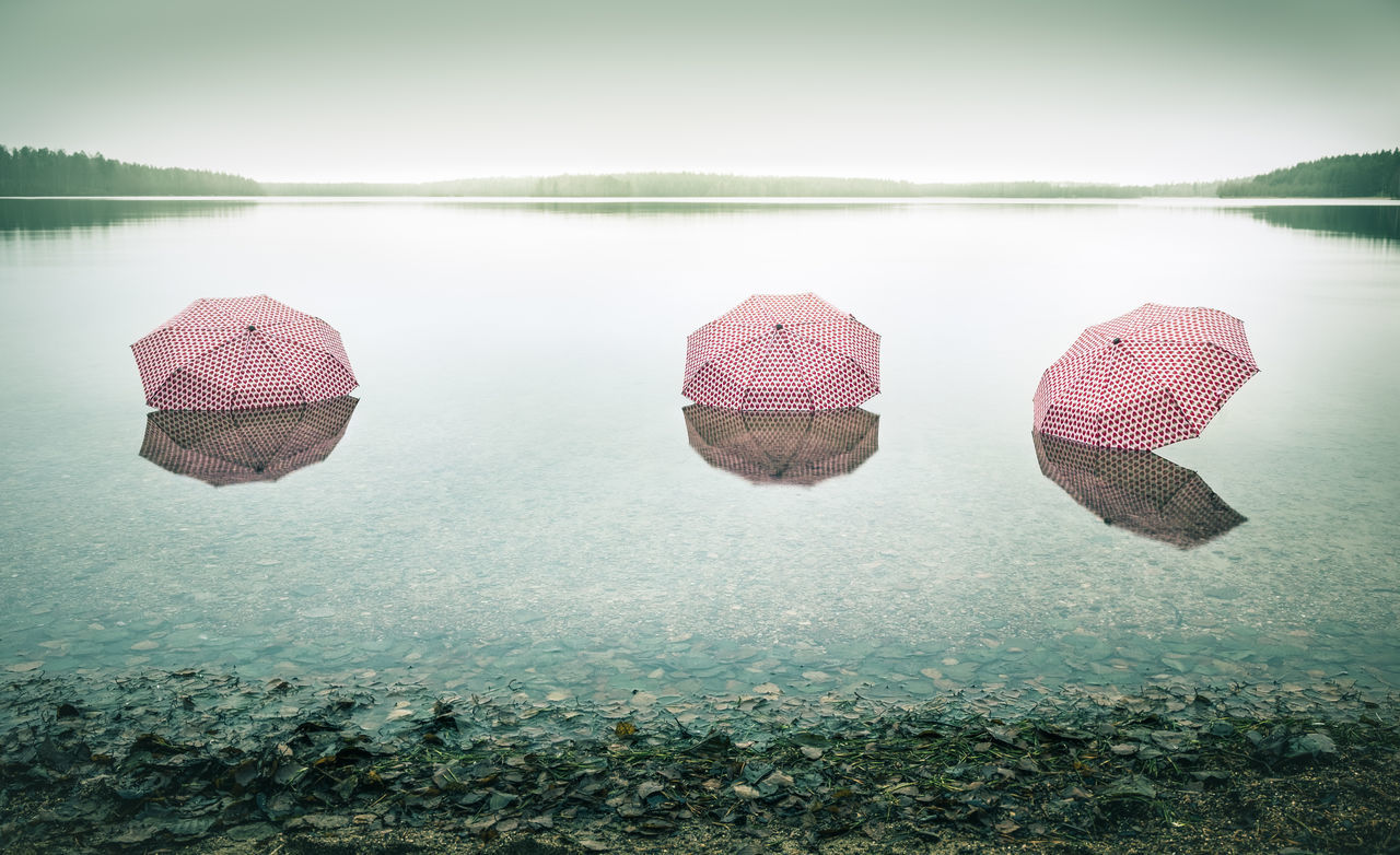 Global warming Beach Calm Floating On Water Fog Foggy Global Warming Gloomy Gloomy Weather Green Lake Lake View Landscape Light Mist Misty Nature Outdoors Pink Polluted Pollution Scenics Standing Water Umbrellas Water EyeEmNewHere EyeEmNewHere