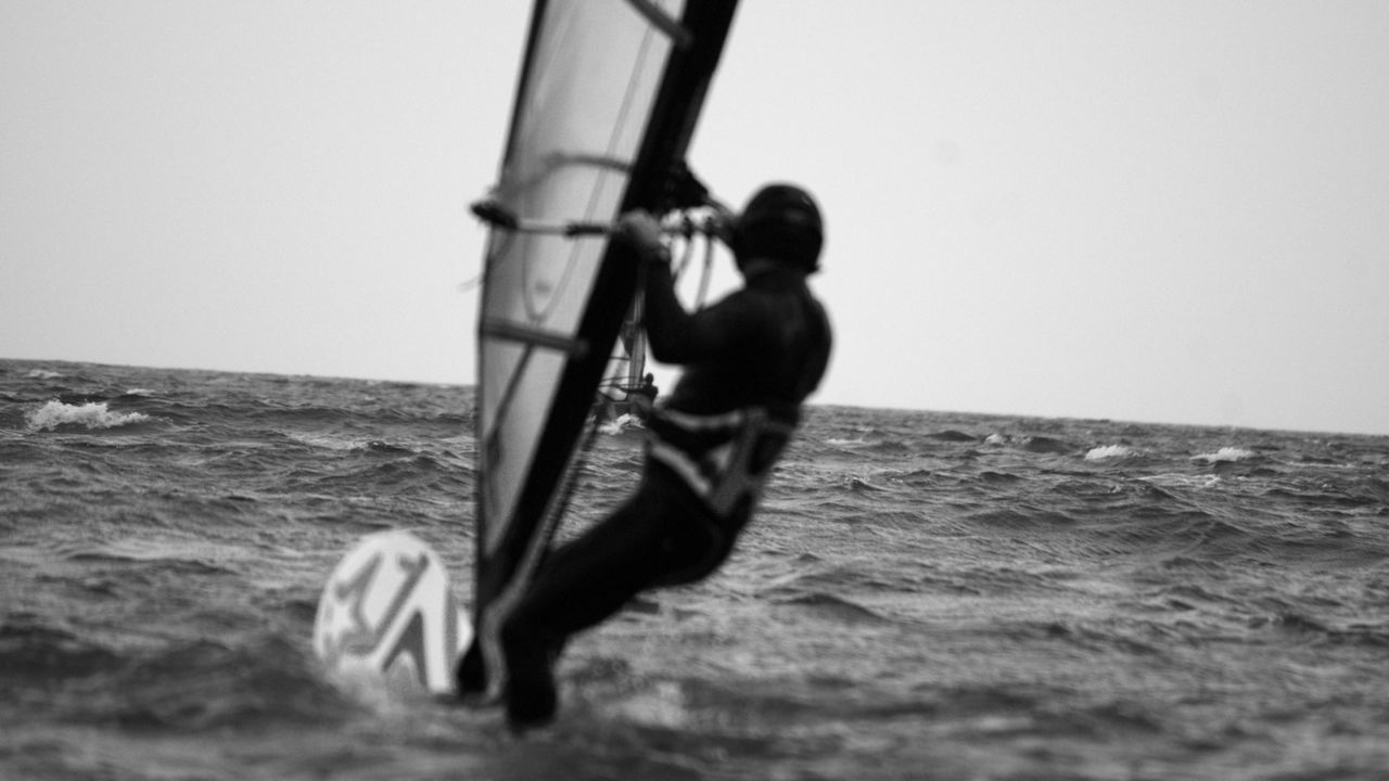 12/13 ..watching you rebel   I won't stop.. Black And White Blackandwhite Clear Sky Confidence  Damaged Focus On Foreground Horizon Over Water Leisure Activity Men Monochrome Motion Sea Seaside Visual Thoughts Water Waves