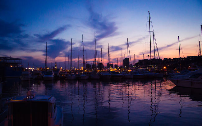 Boat Calm Cloud Cloud - Sky Dock Dramatic Sky Dusk Group Of Objects Harbor Marina Mast Mode Of Transport Moored Nautical Vessel No People Ocean Sailboat Sea Sky Sunset Tranquil Scene Tranquility Transportation Water Waterfront