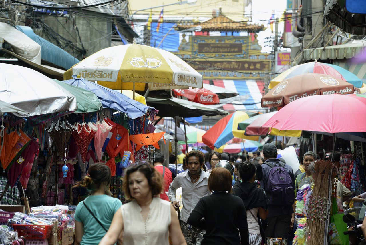market, large group of people, real people, retail, market stall, women, outdoors, day, men, crowd, lifestyles, tent, people