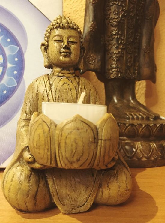 Buddha figurine with candle Statue Religion Sculpture Human Representation Spirituality Indoors  Place Of Worship No People Idol Day Buddha Buddhism figurine candle