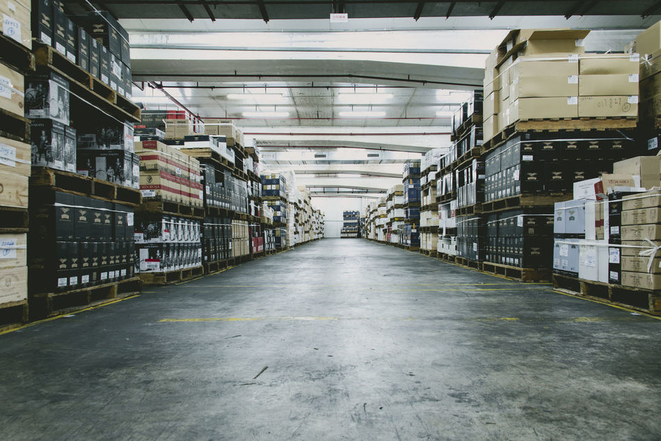 Business Business Finance And Industry Day Distribution Warehouse Indoors  Industry Large Group Of Objects No People Shelf Shipping  Stack Warehouse
