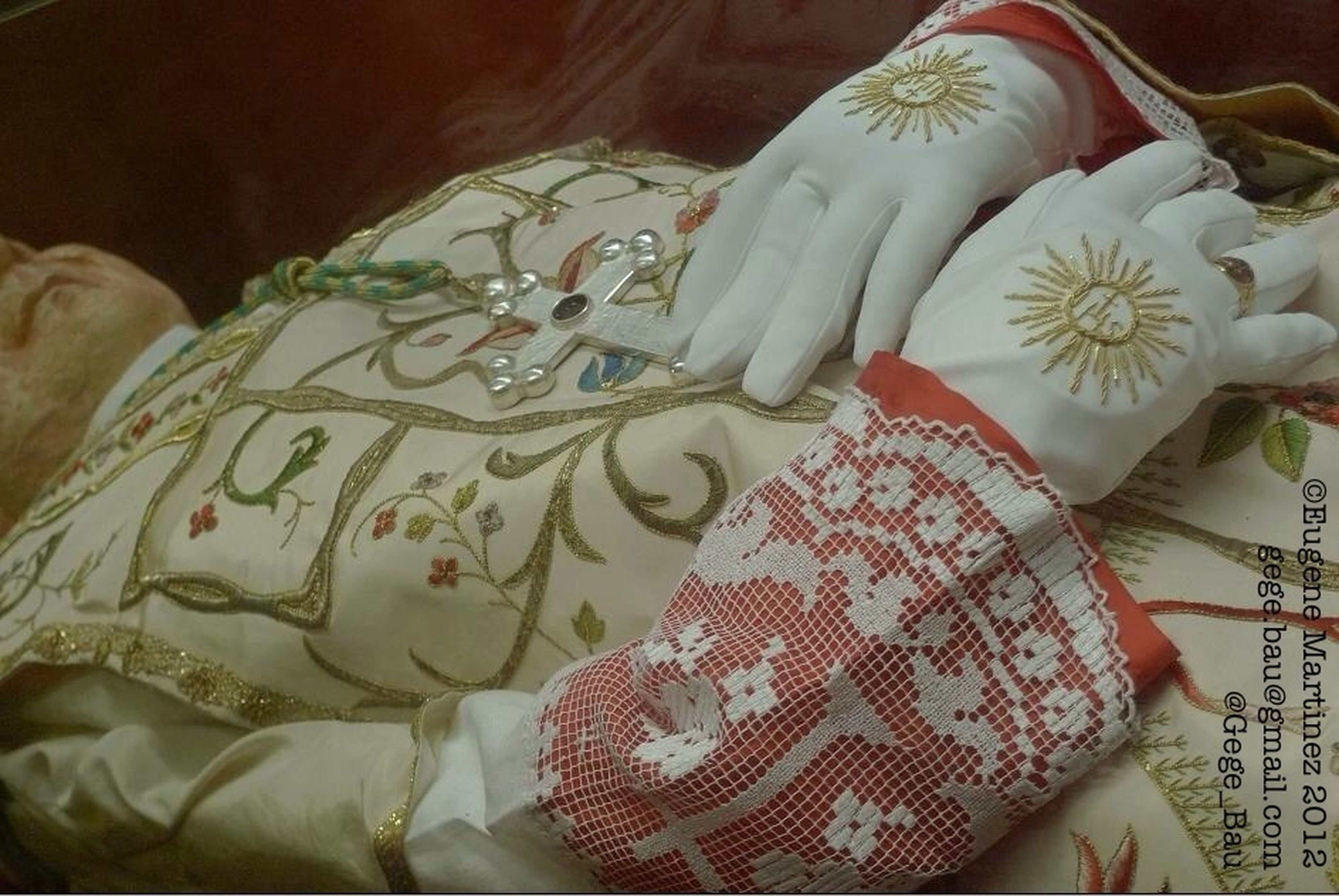 indoors, bed, home interior, art and craft, art, creativity, high angle view, fabric, floral pattern, close-up, pillow, textile, human representation, white color, bedroom, still life, design, tradition, blanket, sofa