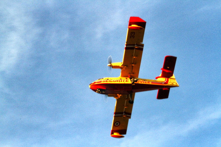 Blue Bomber Canadair Canadair CL-415 Canadair CL215 Cloud - Sky Day High Section Low Angle View No People Outdoors Plane Road Signal Sky Tall - High Water Bomber