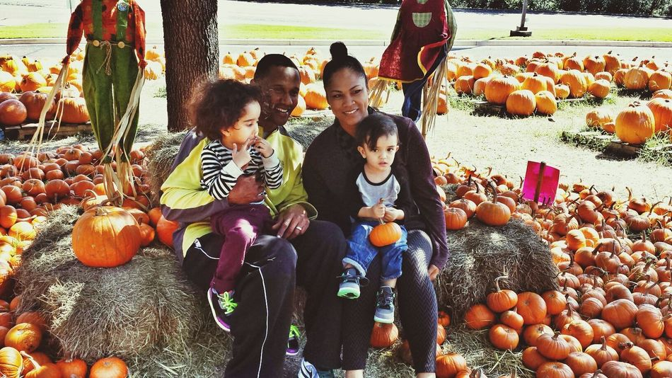 Cassius and Orion taking break with Pops and Granny Pumpkin Patch