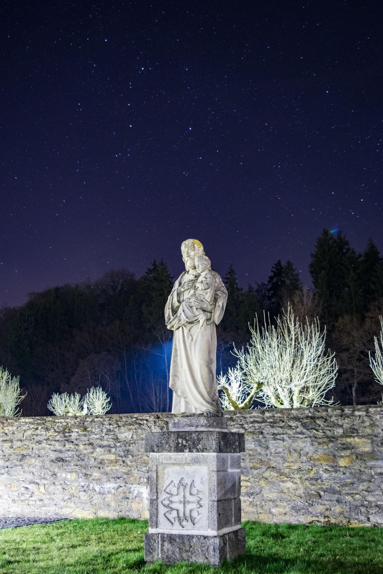 """Sculpture in Monastery """"Marienstatt"""" Illuminated Landscape Night No People Outdoors Religion Religious Art Sculpture Sky Spirituality Stars Statue"""