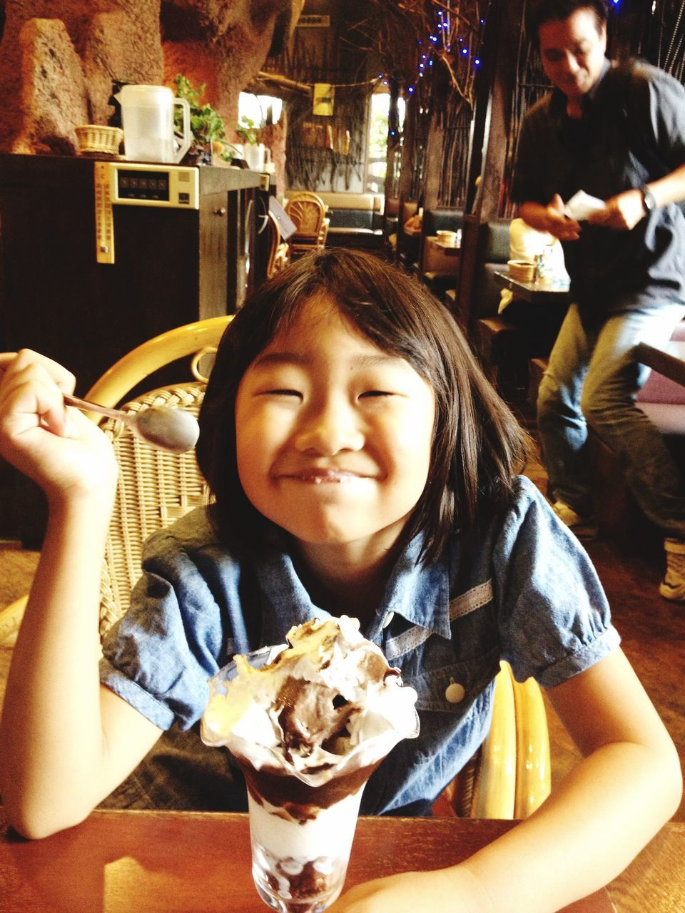 smiling, food and drink, ice cream, happiness, food, real people, looking at camera, childhood, portrait, sweet food, indoors, dessert, cheerful, eating, boys, frozen food, freshness, one person, day, close-up