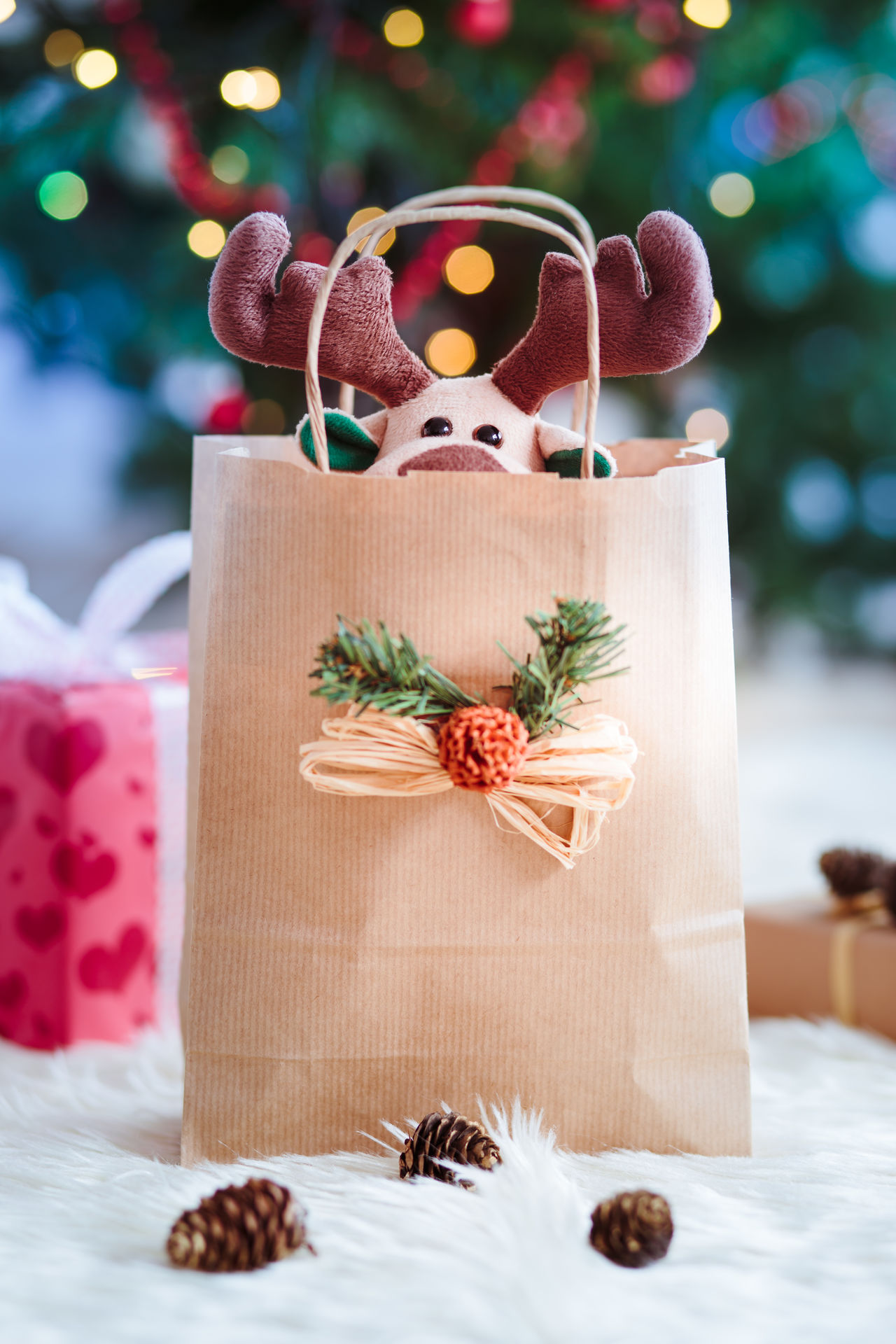 Reindeer toy in a paper bag for Christmas gift Bag Blur Blurred Celebrating Celebration Christmas Gift Holiday Holidays Indoors  Light Packed Paper Present Reindeer Season  Toy Tradional Tree