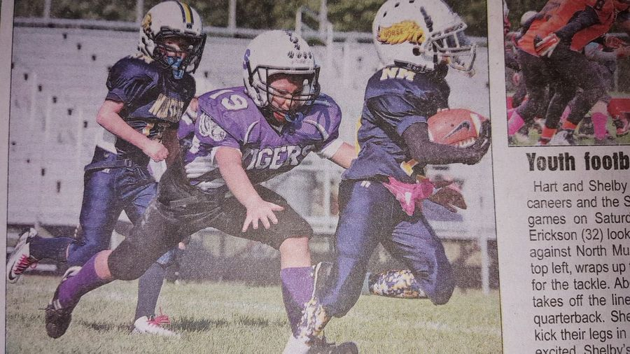 My oldest son Kadin makes the Oceana Herald. A action photo of him putting the smack down making a tackle.