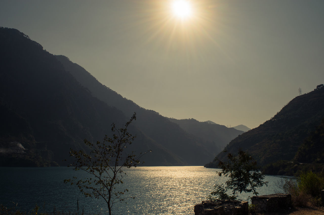 mountain, sun, sunlight, nature, tranquility, tranquil scene, beauty in nature, scenics, water, no people, sky, outdoors, scenery, lake, mountain range, sunset, landscape, day