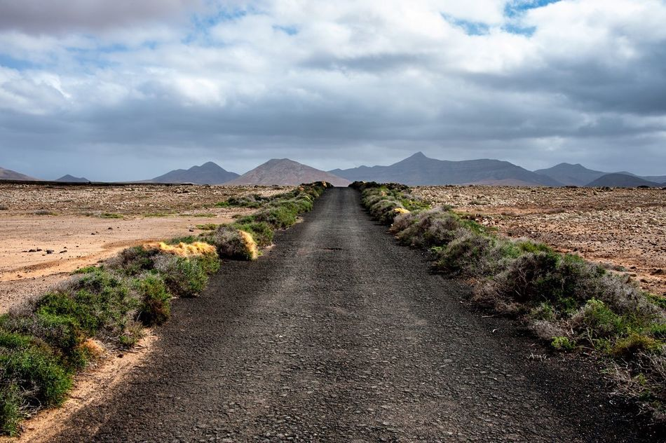 Go ahead ... Until the land ends and ocean explodes ! Canary Islands Landscape Raw Rocks Wanderlust Traveling Travel Travel Destinations Road Black Horizon Infinity On The Road Moving Way Freedom Outdoors Sky And Clouds