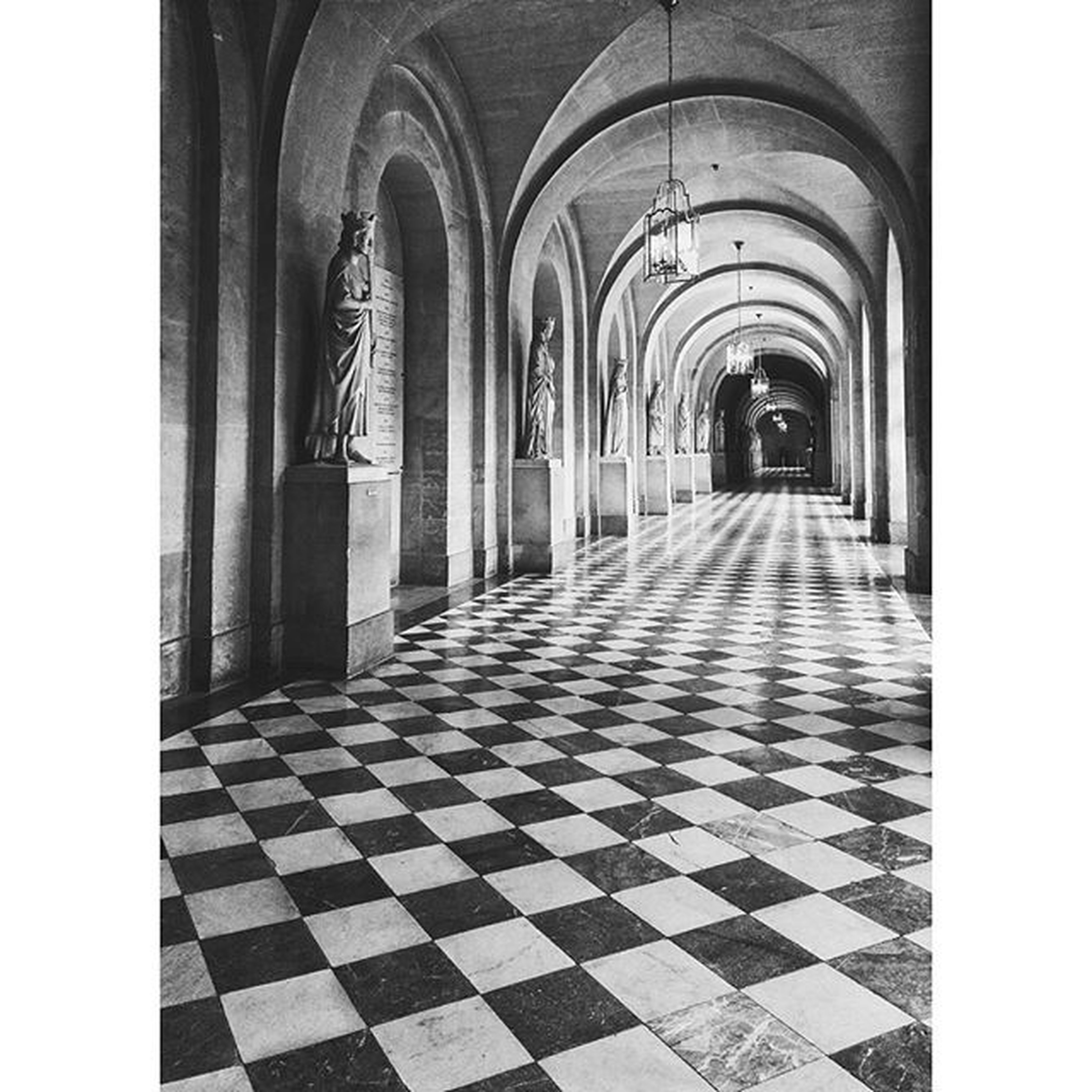 indoors, arch, architecture, the way forward, built structure, corridor, tiled floor, transfer print, diminishing perspective, empty, flooring, auto post production filter, in a row, day, absence, cobblestone, place of worship, vanishing point, walkway, entrance