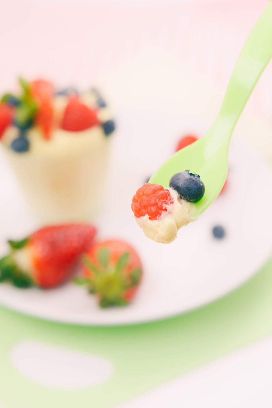 Baby spoon coming at the viewer from an angle filled with fresh and healthy raspberries, strawberries and blueberries. Artful And Beautiful Baby Food Blueberries Close-up Coming At Viewer From An Angle Delicious Colorful Food Female Audience Food Food And Drink Food For Babies Fresh And Healthy, Freshness Fruit Fun And Colorful But Elegant Healthy Eating Healthy Living Highkey Indoors  Mother And Child Pastel Colors Raspberries Ready-to-eat Selective Focus Sophisticated Adult Strawberry