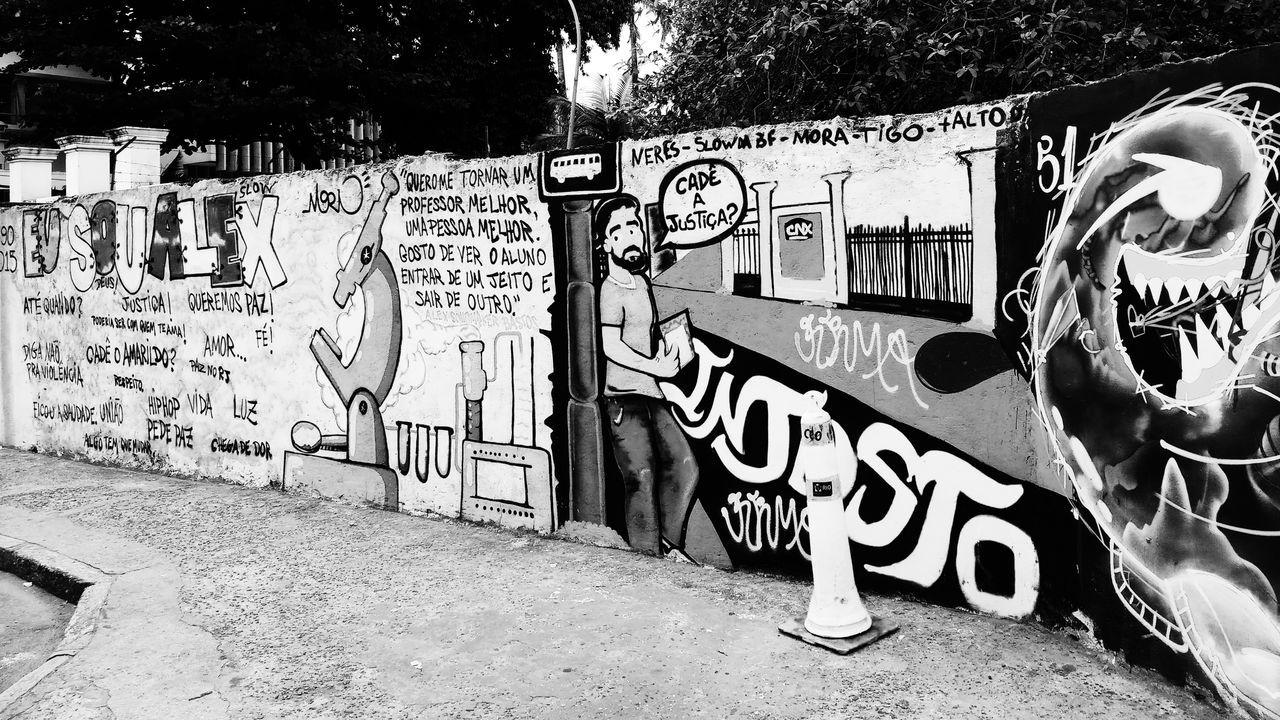 Political graffiti on a wall in Botafogo. Brazilian Communication Creativity Crime Graffiti Justice Political Graffiti Art Political Street Art Portuguese Text Monochrome Black And White Contrast City Life