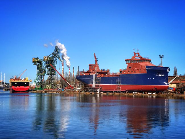 Shipbuilding Yard Ship Building Poland Gdansk Outdoors Day Nautical Vessel Transportation Industry Waterfront Sea Shipping  Water Harbor Commercial Dock Clear Sky Ship No People Moored Industrial Industry Steel Industry Heavy Industry Clear Sky