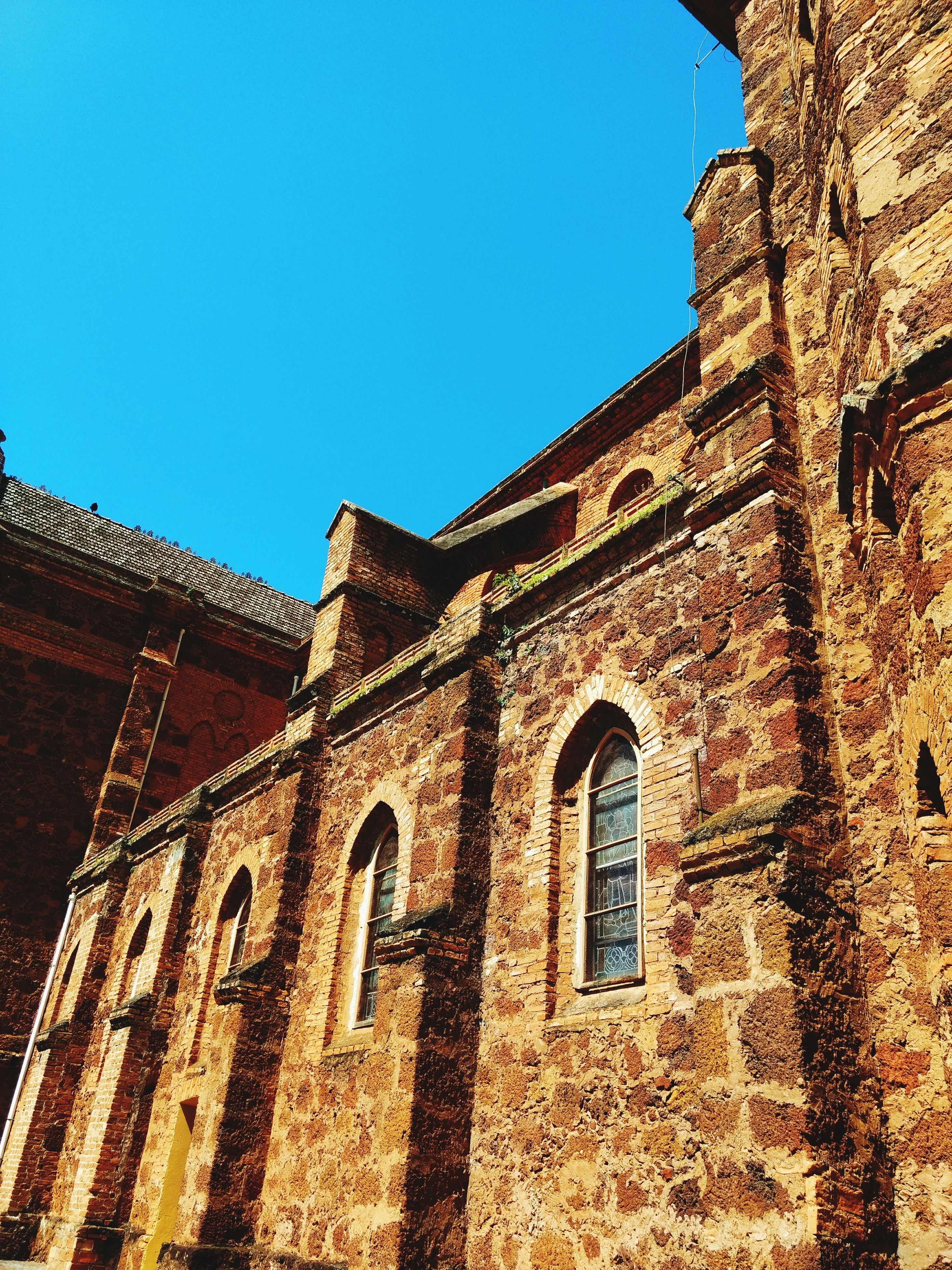 building exterior, architecture, built structure, low angle view, clear sky, blue, no people, history, outdoors, day, place of worship, close-up, sky