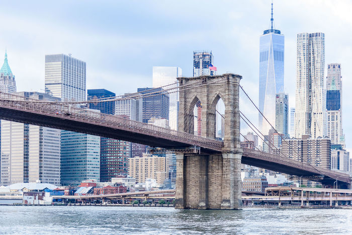 Brooklyn Bridge  New York Architecture Bridge - Man Made Structure Building Exterior Built Structure City Cityscape Connection Day Modern No People Outdoors River Sky Skyscraper Tall Tall - High Tower Transportation Travel Destinations Urban Skyline Water Waterfront