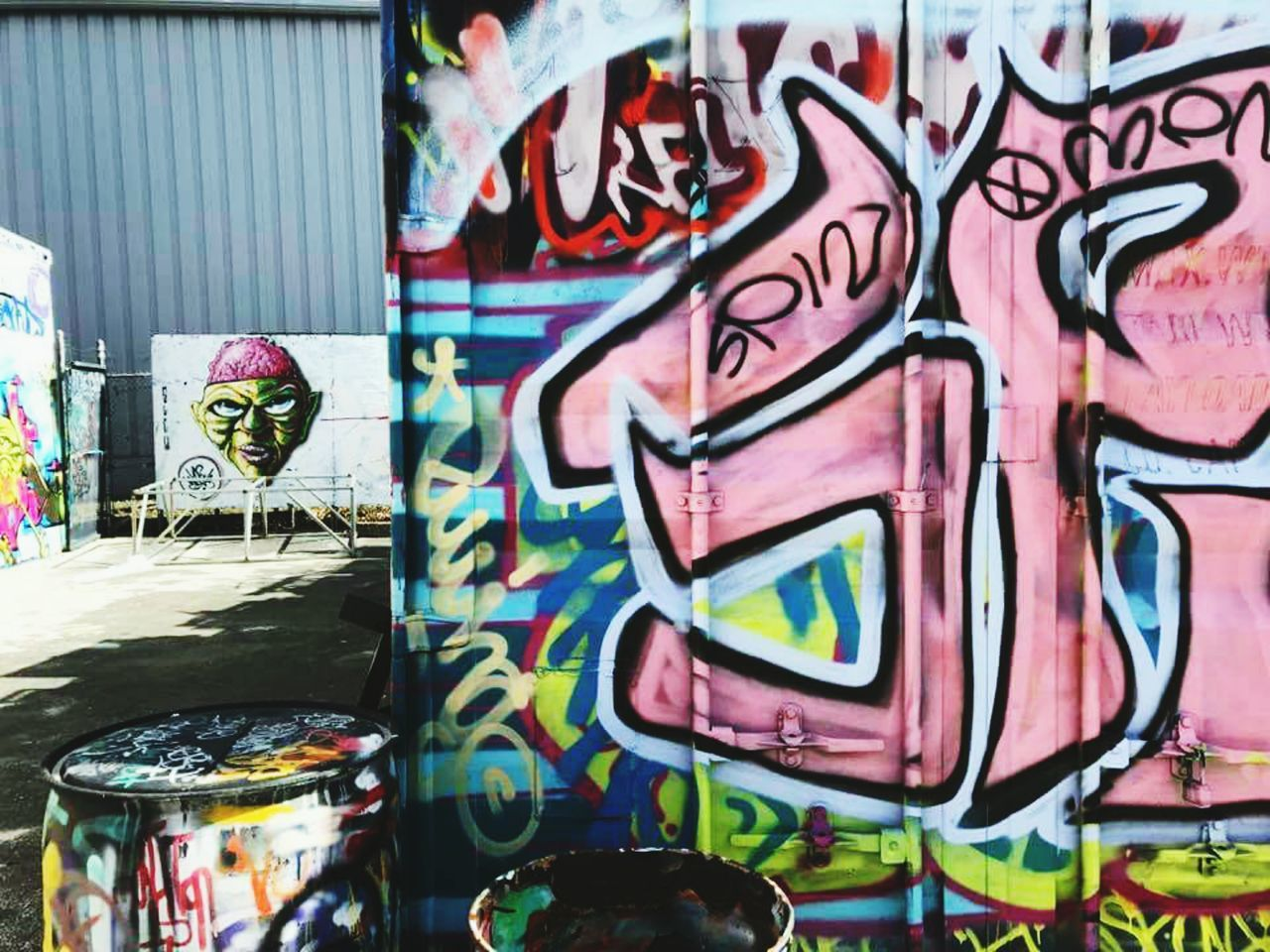 Graffiti Art And Craft Street Art Multi Colored Building Exterior Text No People Outdoors City Day Architecture Close-up Spray Paint