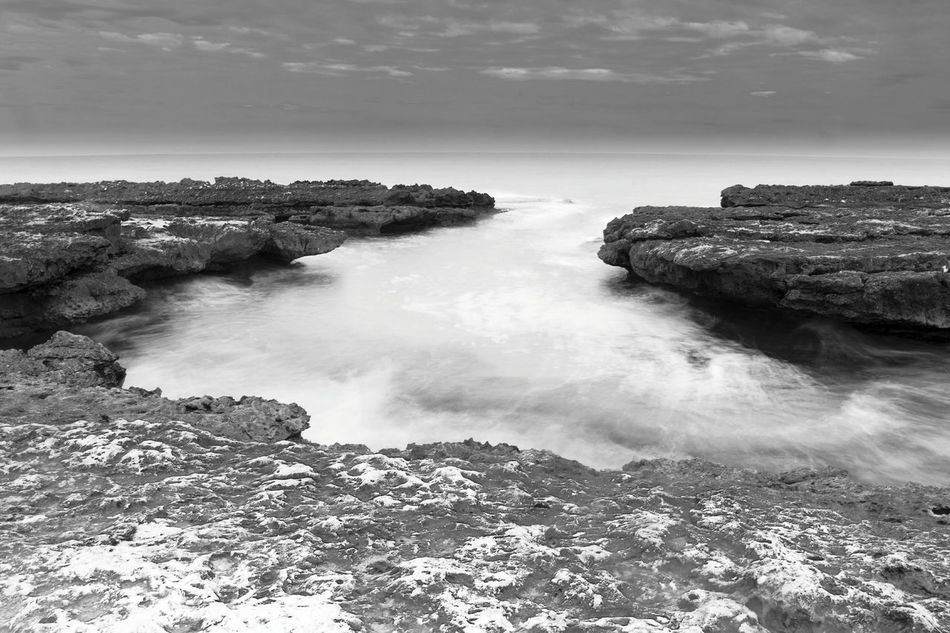 Horizon Over Water Sea Landscape Nature Beauty In Nature Wave Water Peaceful El Campello Los Baños De La Reina Monochrome Monochrome Photography Blackandwhite Black & White Blackandwhite Photography Slowshutter Slow Shutter Long Exposure Capture Peaceful Place Horizon Over Sea Beach Outdoors Waves, Ocean, Nature Waves And Rocks Rocks And Water Rocks In Water