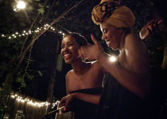 Night Illuminated Lifestyles Young Adult Human Face Smile Beauty Black Portrait Photography Young Women Headdress Portrait Of A Woman Afrocentric  Enjoying Life Culture Strong Woman Black Woman Somolian Black Is Beautiful Blackness Woman Portrait Best Friends Headwrap  Low Angle View