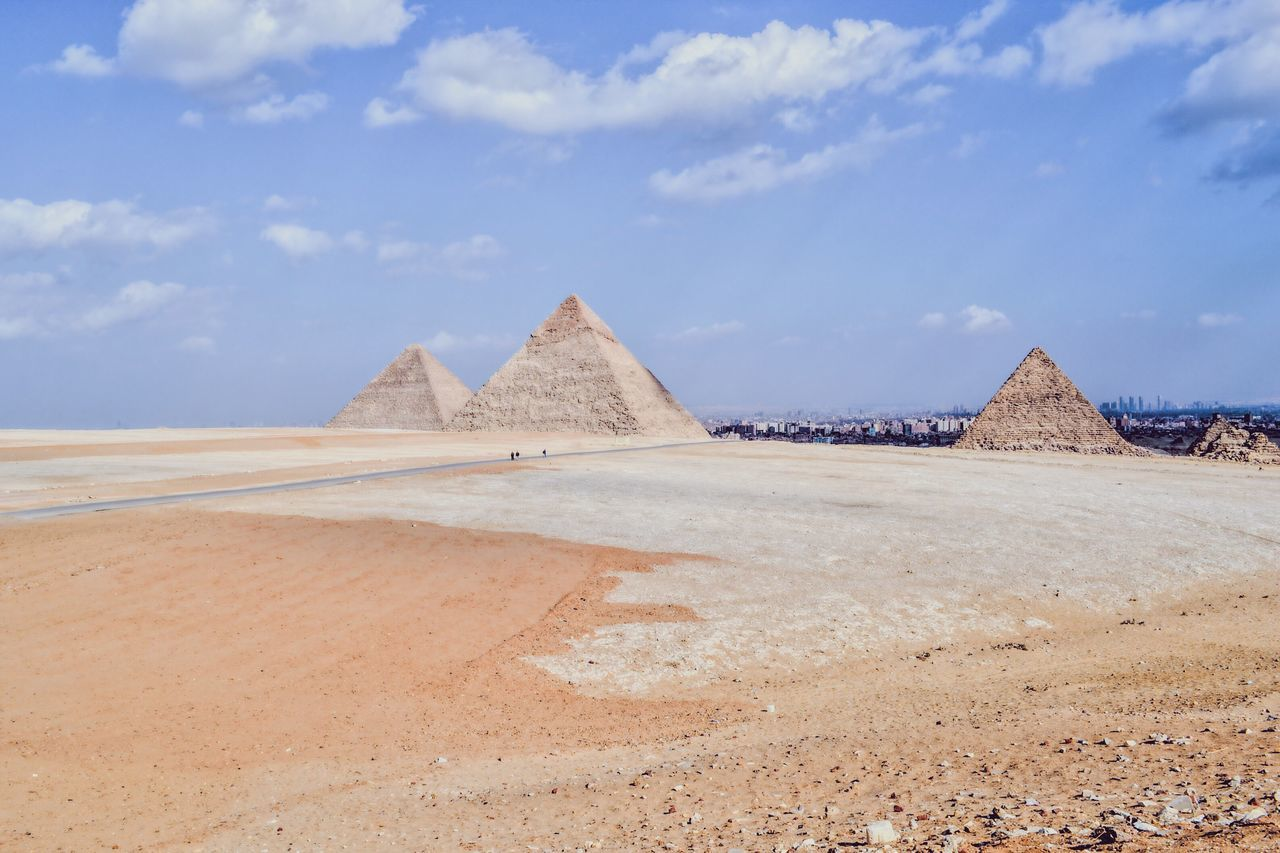 View Of Pyramids Against Cloudy Sky