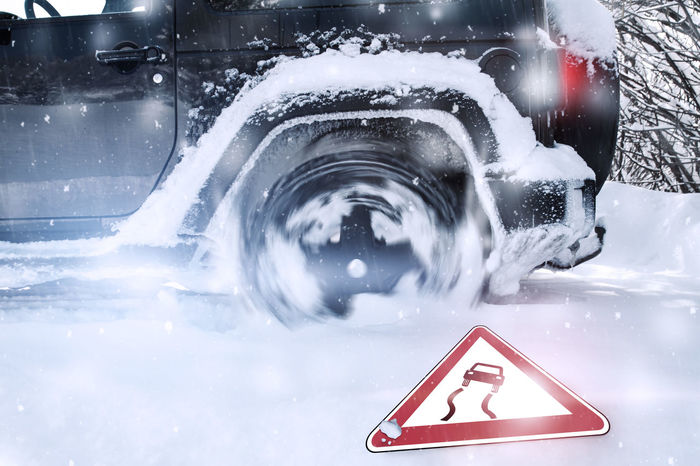 Wheelspinning of car tires at wintertime in a snowy road with fallen traffic sign Drifting Ice Snow ❄ Wheel Winter Car Drift Fall Land Vehicle Outdoors Slide Slippery Slippery Roads Smoothness Snow Snowy Traffic Sign Transportation Wheelspin Winter