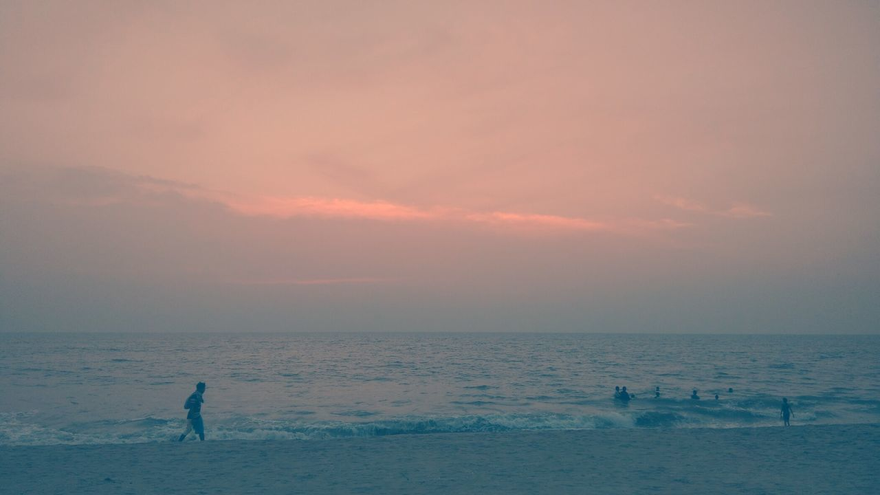 Sunset Sea Beach Horizon Over Water Silhouette Water One Person Sun One Man Only Sky Reflection People Tranquility Beauty In Nature Only Men Standing Vacations Outdoors Summer Full Length Perspectives On Nature EyeEmNewHere