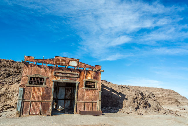 Abandoned building in the UNESCO World Heritage ghost town of Humberstone in Chile Architecture Building Chile Dust Factory Heritage Humberstone Industrial Iquique Landscape Nitre No People Old Outdoors Salitrera Saltpeter Saltpetre Sand Santa Laura Site Sunny Town UNESCO World Heritage Site Village Works