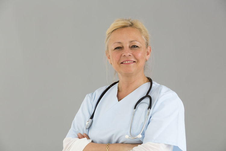 Posing Reassuring Reassure Trust Self Confidence Self Confident Selfconfident Crossed Arms Front View Looking To The Camera Looking At Camera Smiling Stethoscope  Portrait Beautiful Woman Clinic Doctor  Hospital Nurse Reassurance White Background Pediatrics Pediatrician Medical Medical Team