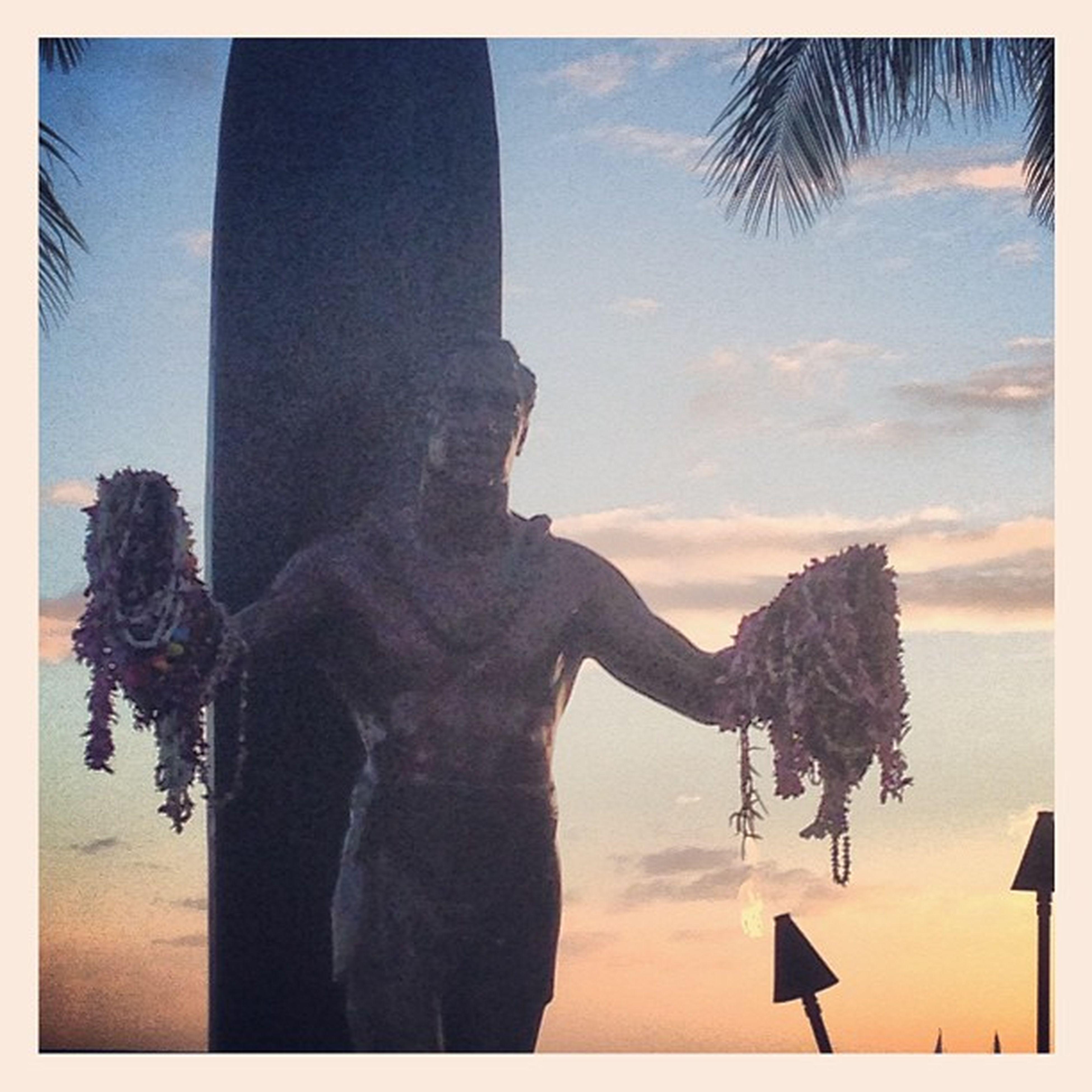Hawaiiandude Statue Leis Respect surfer surfboard hawaii waikiki oahu sunset sky scenery