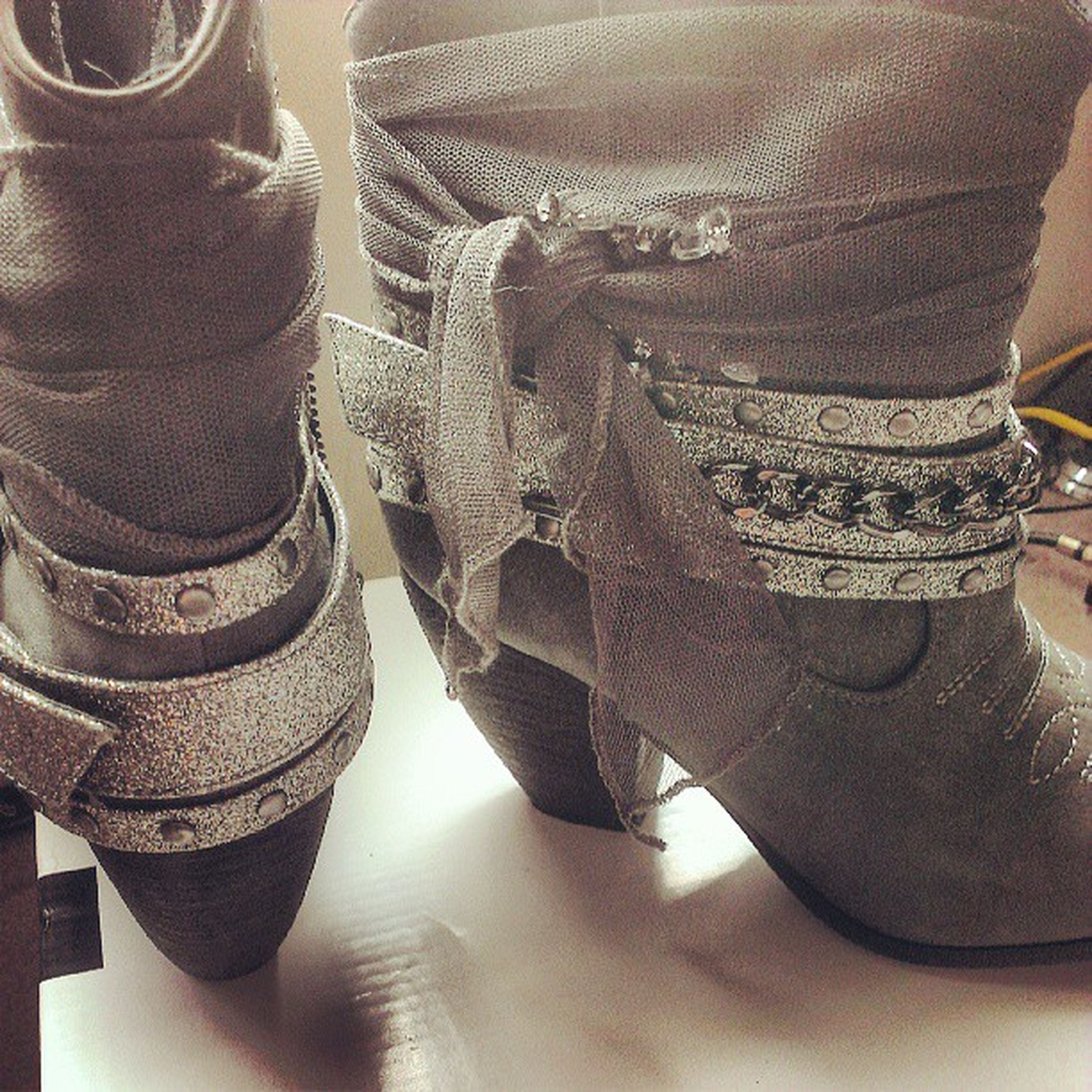low section, person, shoe, indoors, high angle view, footwear, human foot, jeans, flooring, standing, chair, close-up, day, fashion, part of, pair, lifestyles