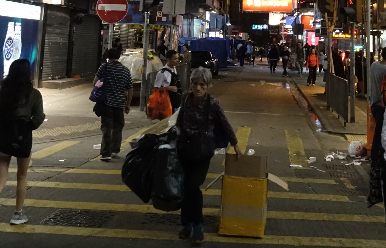 Street at Night City Life Lifestyles Night People And Places Street Photography Carton Box working woman Poor People