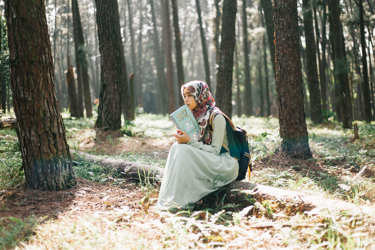 Beautiful women is reading her book alone at pine tree farm. Adult Beautiful Nature Beautiful People Beauty Beauty In Nature Fashion Forest Girl Lanscape Leaves Nature Outdoors People Pine Portrait Portrait Of A Woman Smiling Travel Travelling Tree Walking Women Young Women