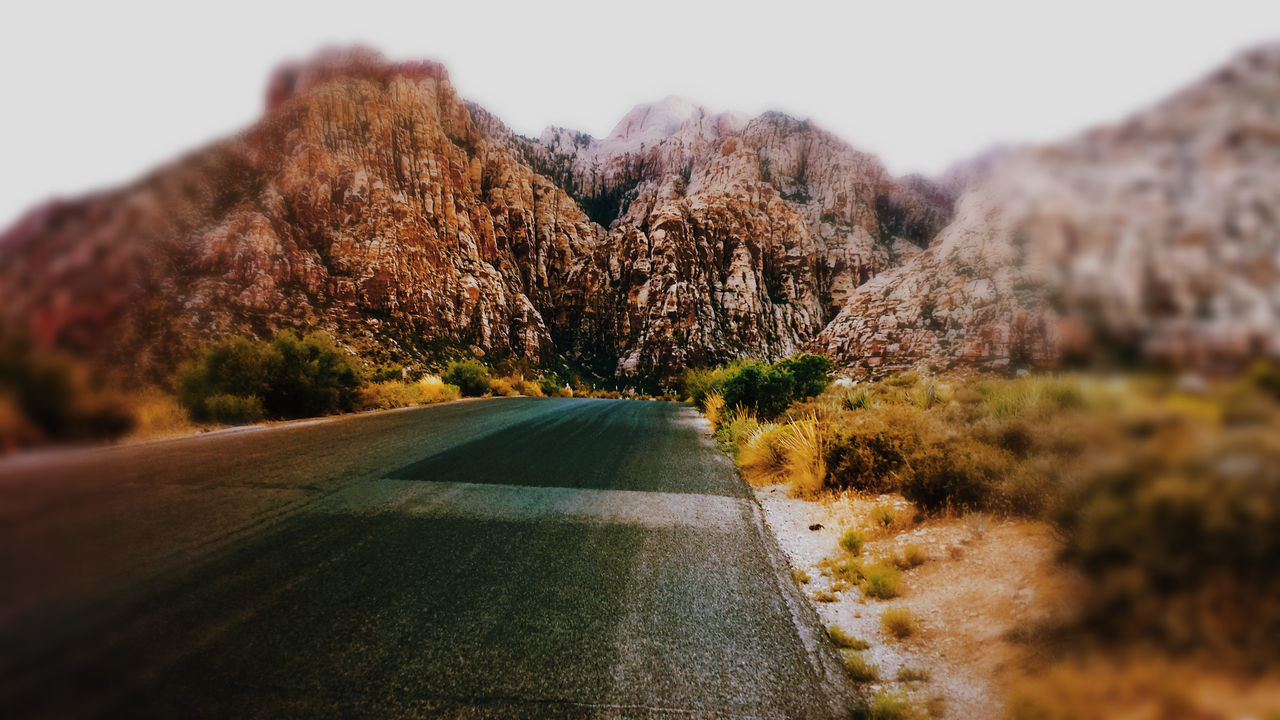 Red Rock, Las Vegas, Nevada Highwayphotography Mountains And Sky Road Trip Blurred Background Perspective Outdoors Road Empty Journey The Way Forward Diminishing Perspective Asphalt Road Marking Distant Country Road Check This Out Autum Colors