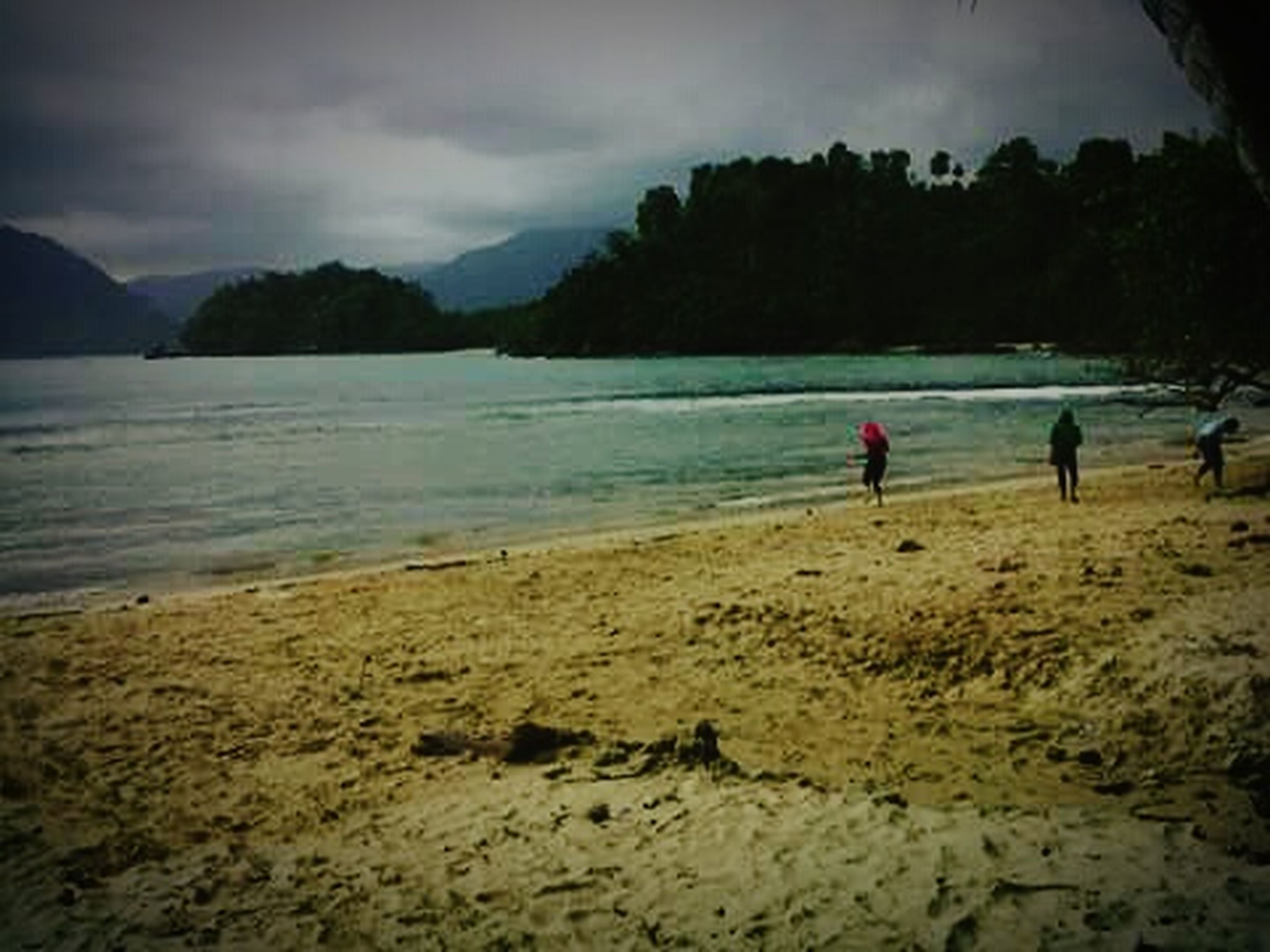 beach, water, sand, sky, shore, tranquil scene, sea, scenics, tranquility, beauty in nature, cloud - sky, leisure activity, nature, mountain, lifestyles, vacations, coastline, idyllic