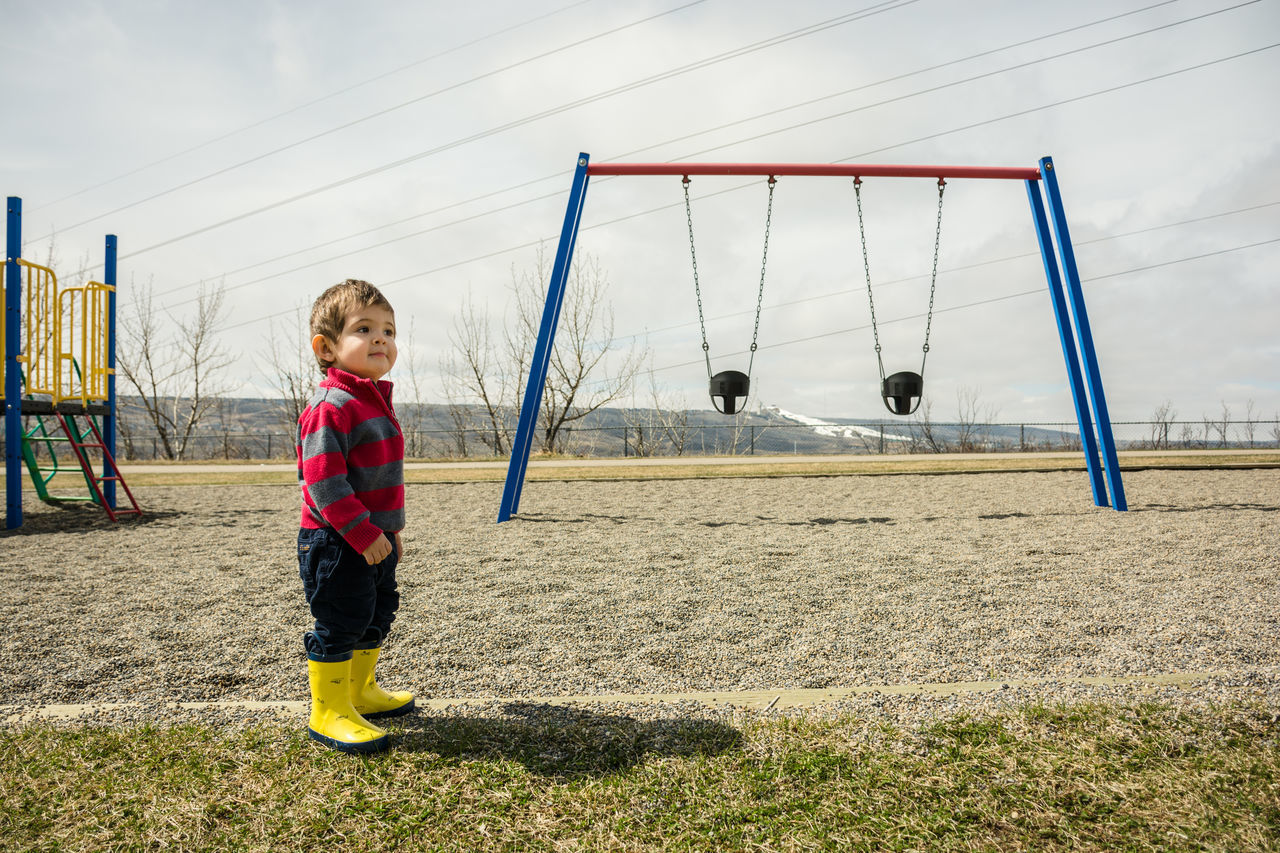 The playground and me Boy Casual Clothing Child Childhood Day Lifestyles Nature Outdoors Park Playground Rainboots Rubberboots Sky Sweater Swings Toddler  Wellington Boots