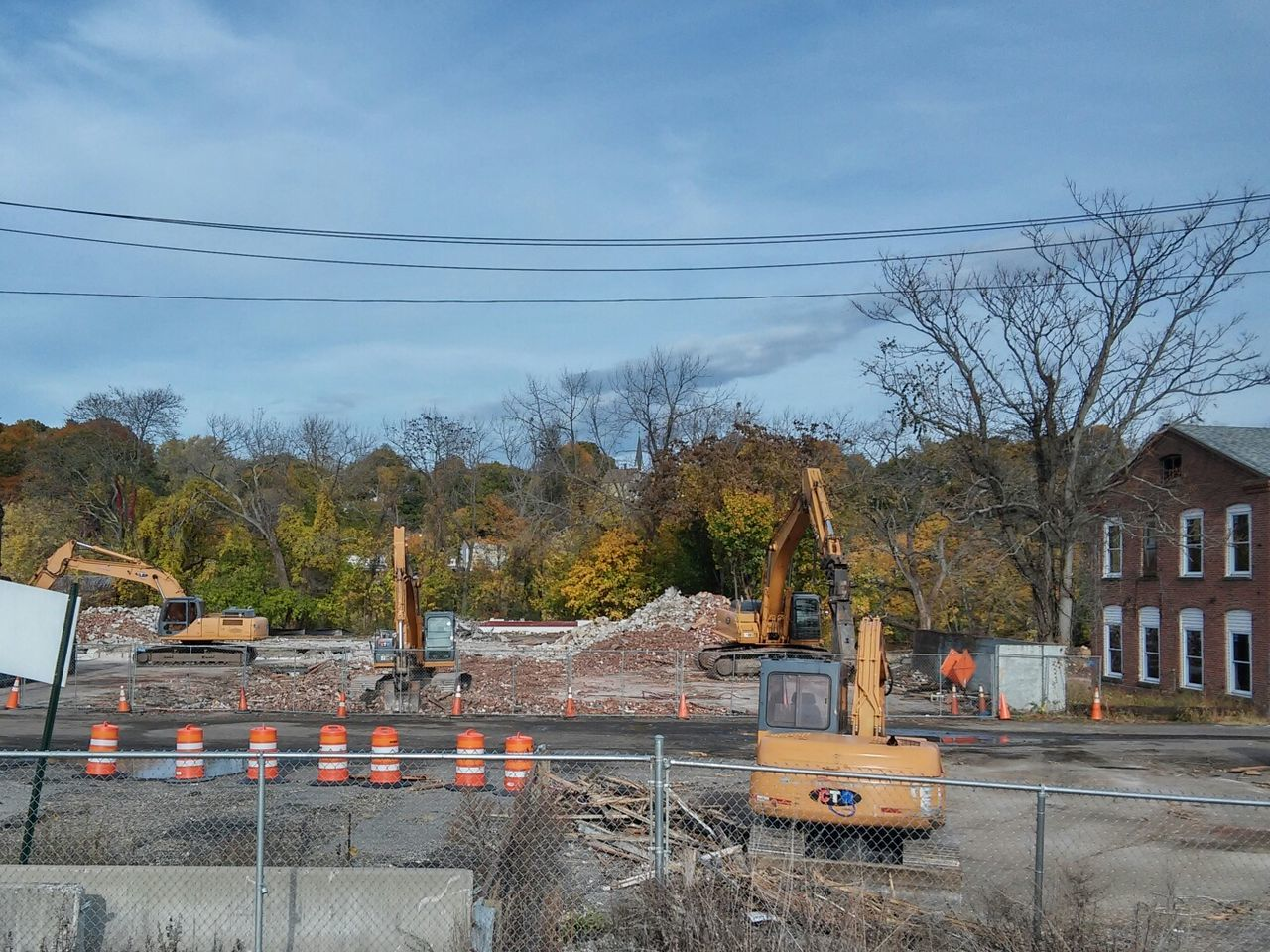 construction site, built structure, architecture, building exterior, tree, day, sky, no people, transportation, outdoors, cable