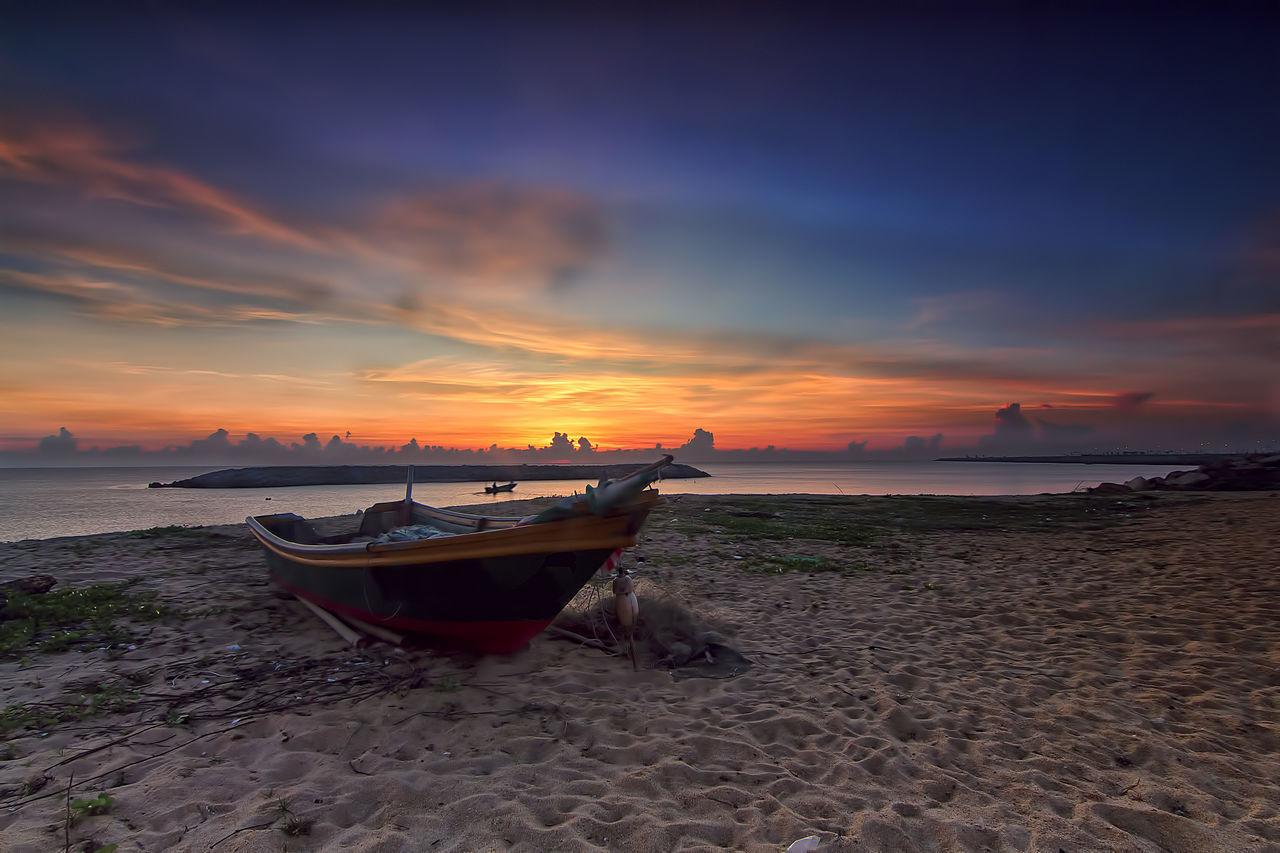 Long Shutter Sunrise at Seberang Takir Beach with a Fisherman boat Backgrounds Beach Beauty In Nature Boat Cloud - Sky Day Horizon Over Water Longtail Boat Mode Of Transport Moored Nature Nautical Vessel No People Outdoors Sand Scenics Sea Shore Sky Sunset The Great Outdoors - 2017 EyeEm Awards Tranquil Scene Tranquility Transportation Water
