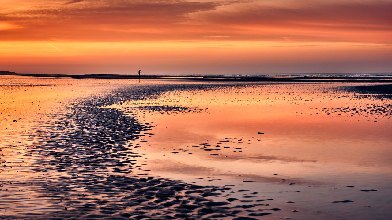 sunset, beauty in nature, nature, sky, scenics, water, reflection, sea, cloud - sky, tranquil scene, tranquility, no people, silhouette, beach, outdoors, horizon over water, day